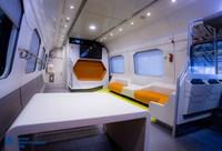 Вид изнутри штабного отдела пассажирского двухэтажного вагона модели 61-4503